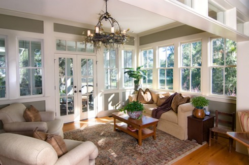 sunroom with large windows and glass doors